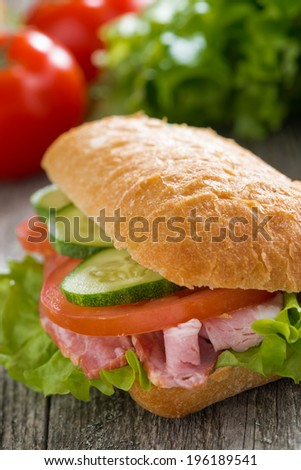 sandwich with ham and fresh vegetables, selective focus, close-up - stock photo
