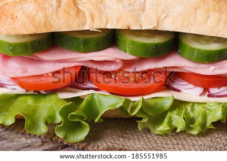 sandwich with ham and vegetables close-up on the table. horizontal. macro   - stock photo