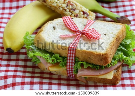 sandwich with ham, apple, banana and granola bar - healthy eating, school lunch - stock photo