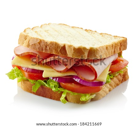 Sandwich with ham, cheese and fresh vegetables isolated on white background - stock photo