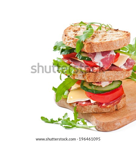Sandwich with ham, cheese and fresh vegetables on white background - stock photo