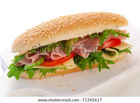 sandwich with ham,cheese and vegetables on white background