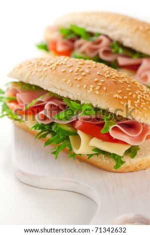 sandwich with ham,cheese and vegetables on white background - stock photo