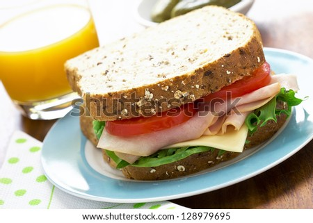 Sandwich with ham,cheese, tomato and lettuce - stock photo