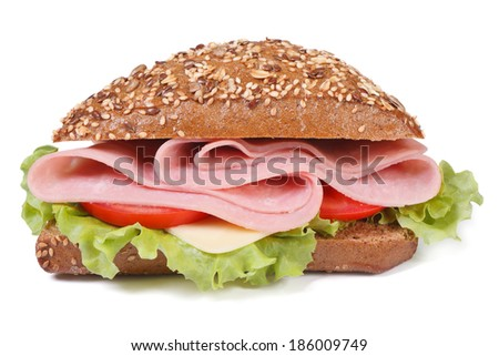 sandwich with ham, cheese, tomatoes and lettuce, sprinkling sesame seeds isolated on white background close-up.  - stock photo
