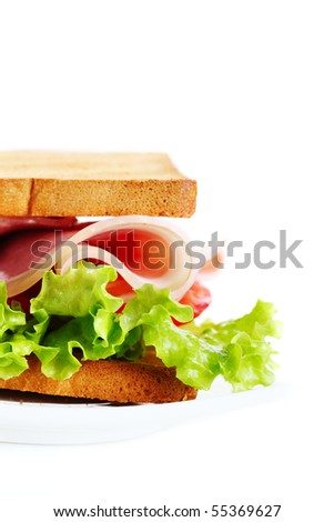 Sandwich with ham, lettuce and tomato on white isolated background