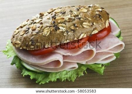 sandwich with ham on wooden background - stock photo