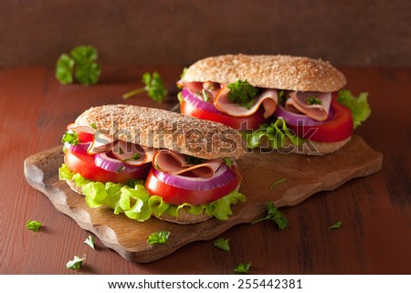 sandwich with ham tomato and lettuce - stock photo