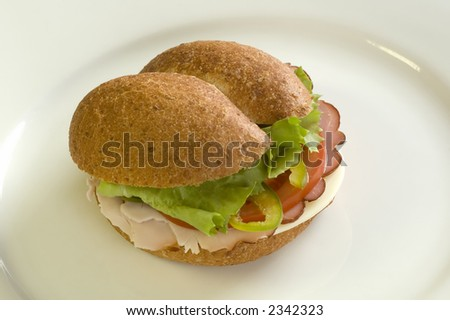 sandwich with ham, tomato, salad and cheese close up