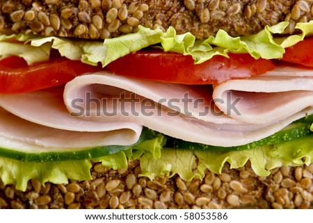sandwich with ham tomatoes and lettuce detail - stock photo