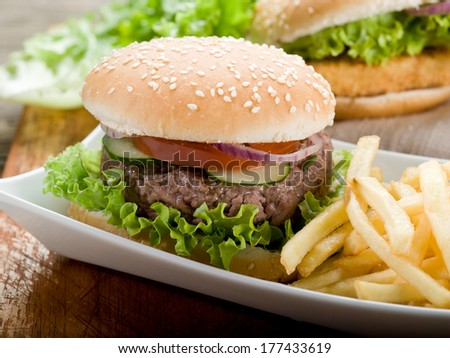 sandwich with hamburger and fried potatoes - stock photo