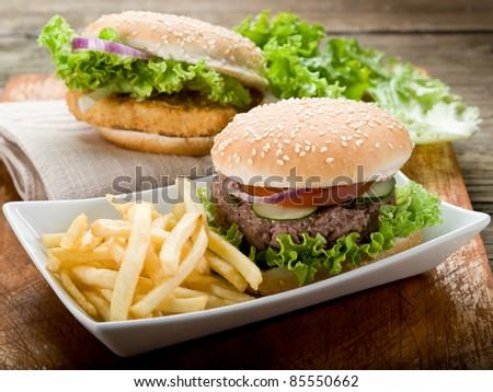 sandwich with hamburger and fried potatoes - stock photo