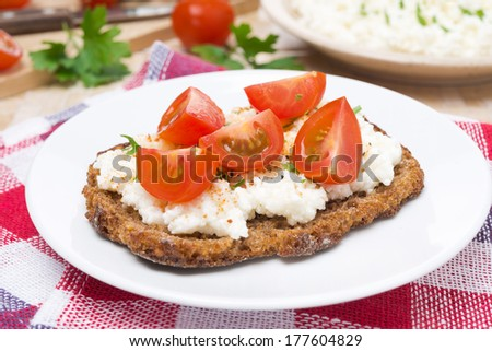 sandwich with homemade cottage cheese, pepper, herbs and cherry tomatoes, close-up, horizontal - stock photo
