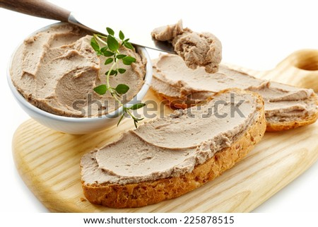sandwich with liver pate on wooden cutting board - stock photo