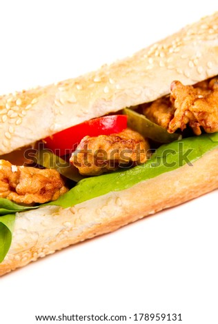 Sandwich with meat and vegetables on white