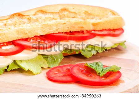 Sandwich with mozzarella, tomato and salad