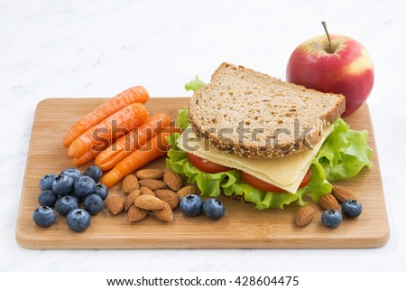 sandwich with of wholemeal bread on the school lunch, horizontal - stock photo