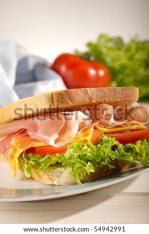 sandwich with parma ham tomato and lettuce - stock photo