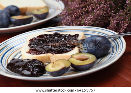 Sandwich with plum jam and fresh plums. Shallow dof