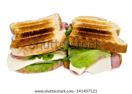 sandwich with salad, cheese and ham on white background - stock photo