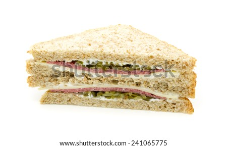 Sandwich with salami, cheese and cucumber. On white background. - stock photo