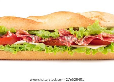 sandwich with salami, cheese, tomato and lettuce - stock photo