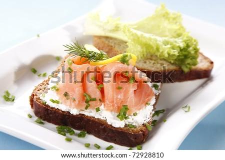 Sandwich with salmon - stock photo