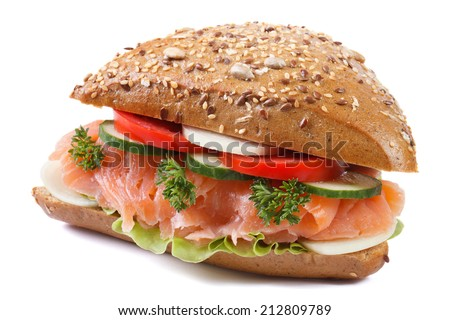sandwich with salmon and vegetables close-up isolated on white background. side view   - stock photo