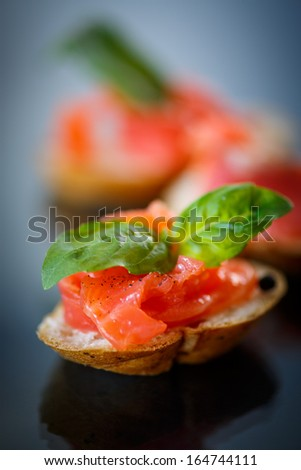 sandwich with salted salmon on a dark background