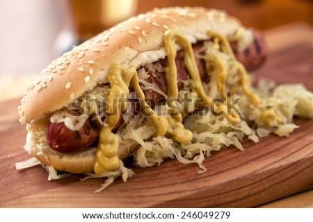 Sandwich with sausage and sauerkraut - stock photo