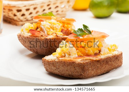 Sandwich with scrambled eggs and bacon. Selective focus. - stock photo