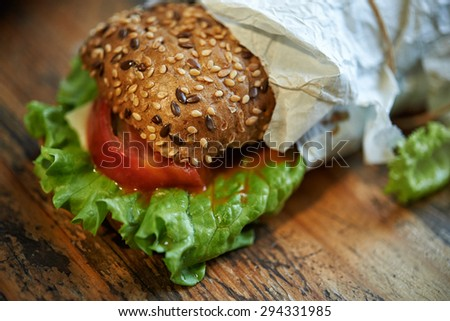 sandwich with sesame seeds on top and tomatoes - stock photo
