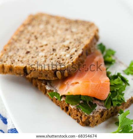 Sandwich with smoked salmon and fresh parsley