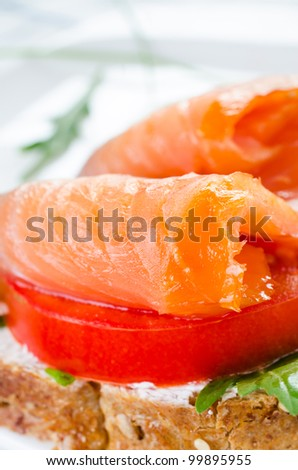 Sandwich with smoked salmon close up