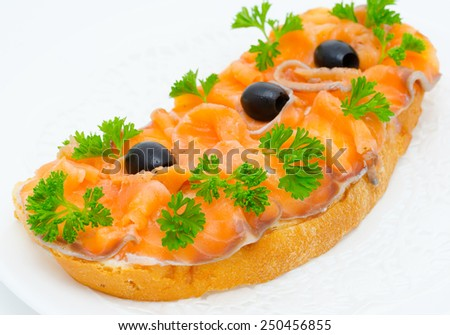 sandwich with smoked salmon, olives and parsley - stock photo
