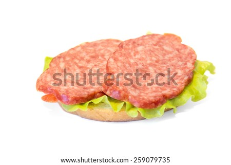 Sandwich with smoked sausage and lettuce on white background - stock photo