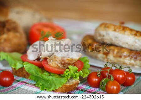 sandwich with tomatoes and homemade sausage with vegetables