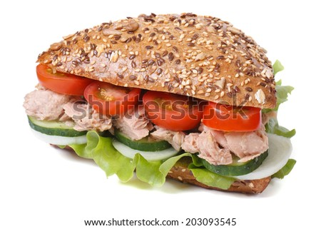 sandwich with tuna and vegetables isolated on a white background closeup   - stock photo