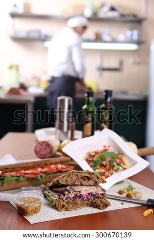 Sandwiches and ingredients on the kitchen