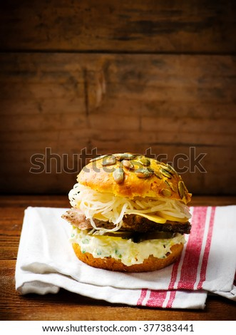 sandwiches with baked pork ,cheese and sauce. style vintage. selective focus