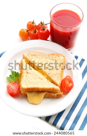 Sandwiches with cheese and tomatoes on plate near glass of tomato juice isolated on white - stock photo