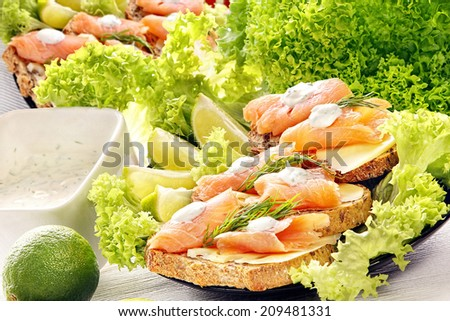 Sandwiches with cheese, salmon and garlic dip