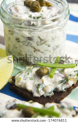 sandwiches with dark bread, herrings, mushrooms, pepper