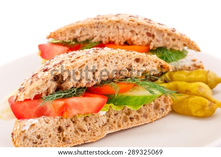 Sandwiches with fresh vegetables and cheese on plate. - stock photo
