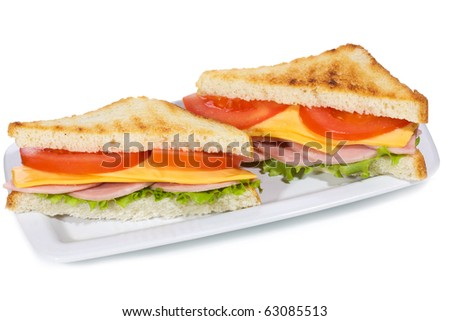 sandwiches with ham and vegetables on white background - stock photo