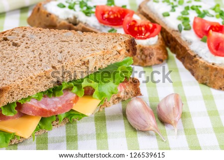 Sandwiches with ham, cheese and fresh tomatoes