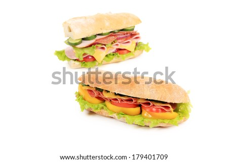 Sandwiches with ham, cheese and tomato. Isolated on a white background.