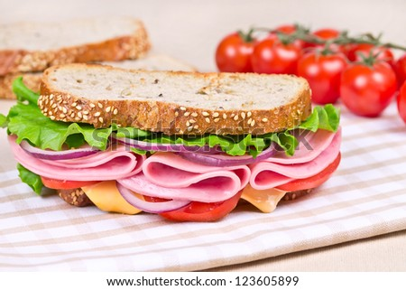sandwiches with ham, cheese and tomato on a wooden board - stock photo