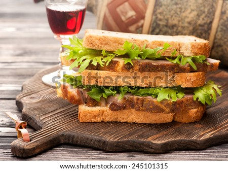 Sandwiches with roasted meat and wine - stock photo