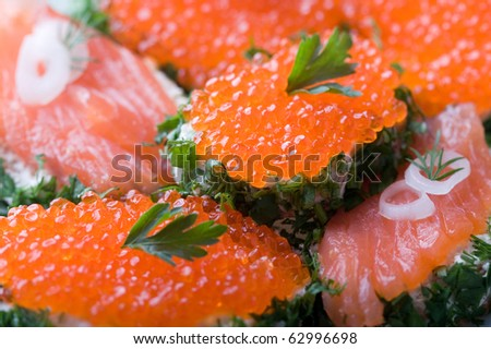 sandwiches with salmon and caviar - stock photo